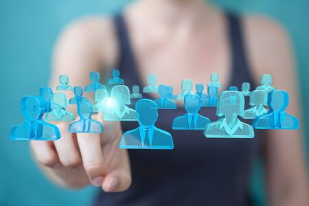rendering: Businesswoman on blurred background holding and touching 3D rendering group of blue people