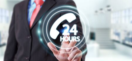 hands  hour: Businessman on blurred background using hotline customer assistance 3D rendering Stock Photo