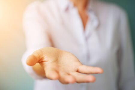 Businesswoman giving one hand on blurred background