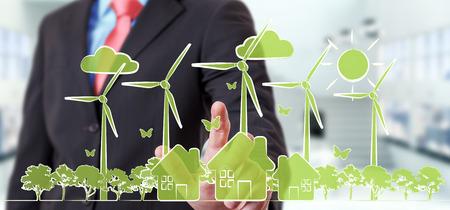 Hombre de negocios en el fondo borroso tocando bosquejo de energía renovable Foto de archivo - 84266657