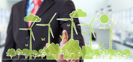 Businessman on blurred background touching renewable energy sketch