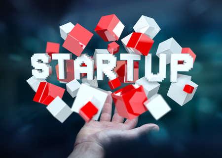 Man on blurred background holding floating 3D render startup presentation with cube
