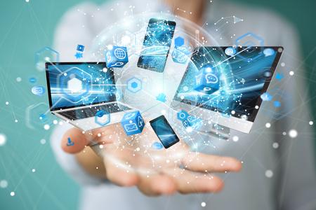Dispositivos de tecnología conectados entre sí por empresaria en la representación 3D de fondo borroso