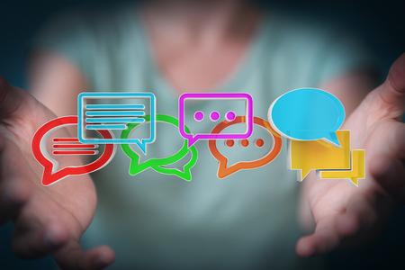 Businesswoman on blurred background using digital colorful 3D rendering conversation icons Standard-Bild