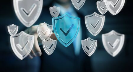 cyber defence: Businessman on blurred background using modern data shield antivirus 3D rendering Stock Photo