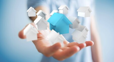 new: Businessman on blurred background using 3D rendered small white and blue houses Stock Photo