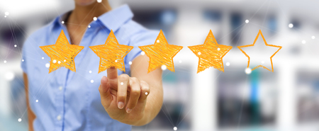 five stars: Businesswoman on blurred background rating with hand drawn stars Stock Photo