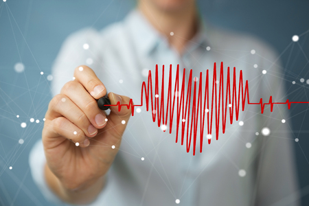 Businesswoman on blurred background drawing a heart beat sketch
