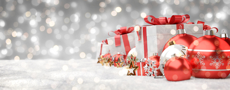 Red and white christmas gifts and baubles lined up on grey snowy background 3D rendering Archivio Fotografico