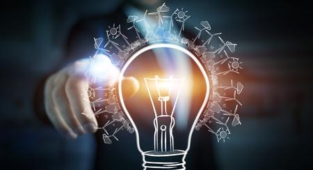 Businessman on blurred background touching renewable eco lightbulb sketch Stock Photo