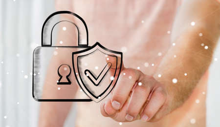 Businessman on blurred background touching a hand-drawn antivirus system Stock Photo