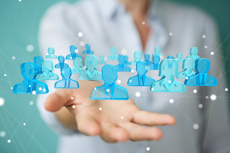 Businesswoman on blurred background holding and touching 3D rendering group of blue people