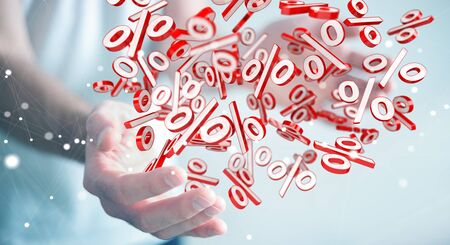 Businessman on blurred background using white and red sales flying icons 3D rendering Stock Photo