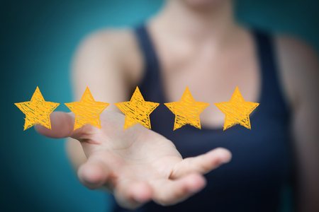 opinions: Businesswoman on blurred background rating with hand drawn stars Stock Photo