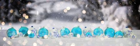 Blue and white christmas baubles and candles on snow background 3D rendering Stock Photo