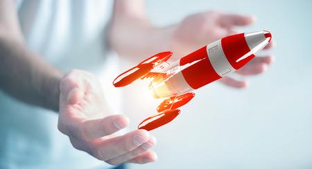 Zakenman op wazige achtergrond met rode raket in zijn hand 3D-rendering Stockfoto