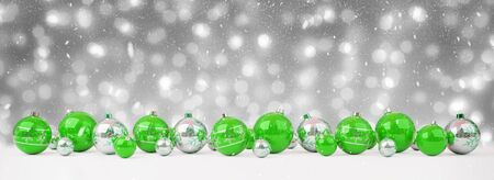 Green and white christmas baubles lined up on snow background 3D rendering Фото со стока