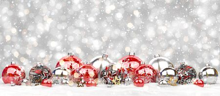 Red and white christmas baubles lined up on grey snowy background 3D rendering Stock Photo