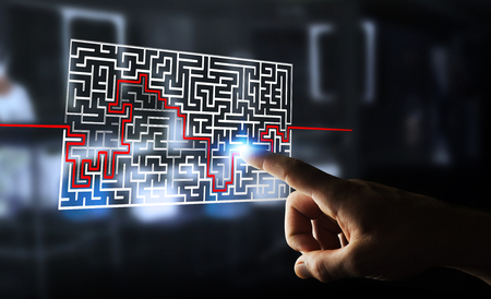 Businesswoman on blurred background searching solution of a complicated maze Stock Photo