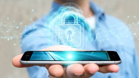Businessman on blurred background using digital padlock on his mobile phone 3D rendering Stock Photo