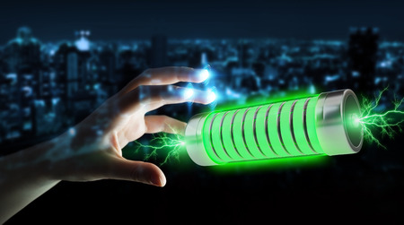 Businessman on blurred background using green battery with lightnings 3D rendering Stock Photo