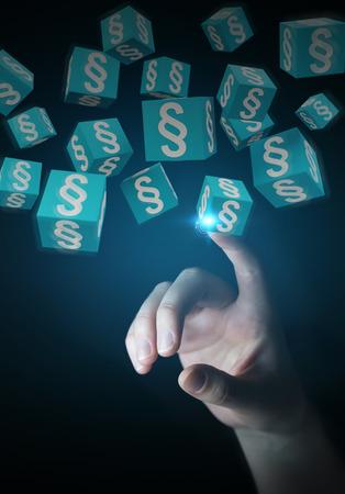 Businessman on blurred background using 3D rendering law cubes Zdjęcie Seryjne