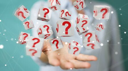 Businesswoman on blurred background using cubes with 3D rendering question marks