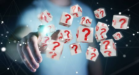 Businessman on blurred background using cubes with 3D rendering question marks Stock Photo