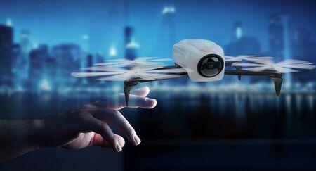 Businessman on blurred background using modern drone 3D rendering Reklamní fotografie