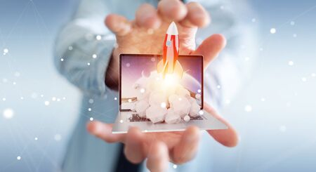 Businessman on blurred background with rocket launching from a laptop 3D rendering