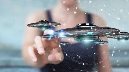 Businesswoman on blurred background with retro UFO spaceship 3D rendering