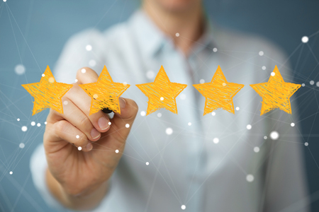 Businesswoman on blurred background rating with hand drawn stars Stock Photo