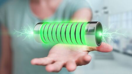 Businessman on blurred background using green battery with lightnings 3D rendering 写真素材
