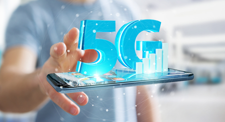 Businessman on blurred background using 5G network with mobile phone 3D rendering