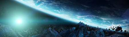 Panoramic view of planet Earth with asteroids flying close in space 3D rendering elements Stock Photo