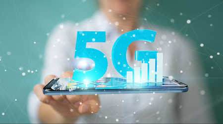 Businesswoman on blurred background using 5G network with mobile phone 3D rendering