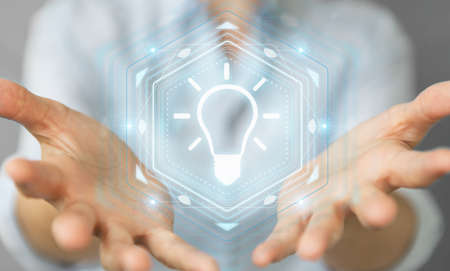 Businesswoman on blurred background using lightbulb idea interface 3D rendering Stock Photo