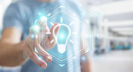 Businessman on blurred background using lightbulb idea interface 3D rendering