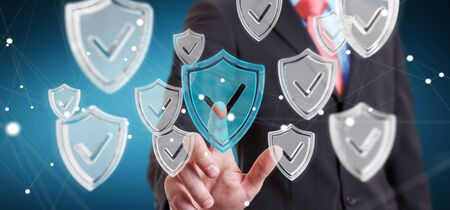 Businessman on blurred background using modern data shield antivirus 3D rendering Stock Photo