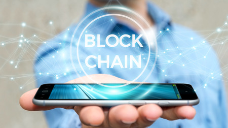 Businessman on blurred background using blockchain cryptocurrency interface 3D rendering