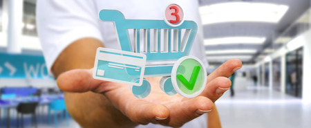 Businessman on blurred background using digital shopping icons 3D rendering 写真素材