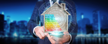 Businessman on blurred background using 3D rendering energy rating chart in a wooden house Stock Photo