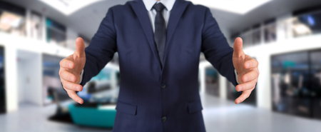 Businessman showing empty hands on blurred background