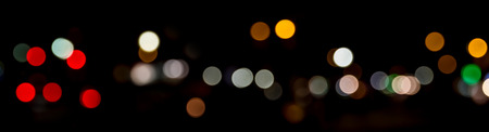 Bokeh traffic light at night in the street of a big city road