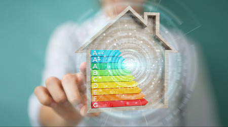 Businesswoman on blurred background using 3D rendering energy rating chart in a wooden house
