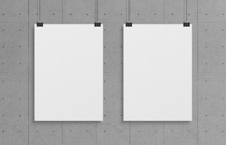Two blank white poster hanging up with in front of concrete wall clips mockup