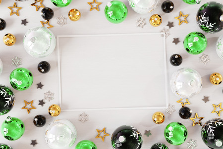Christmas card mockup on white wood with green baubles 3D rendering