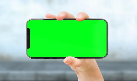 Woman hand holding modern smatphone mockup on white background