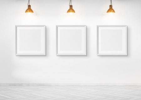Three squared frames hanging on a white wall mockup 3d rendering
