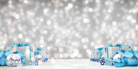 Blue christmas gifts and baubles lined up on grey background 3D rendering Фото со стока